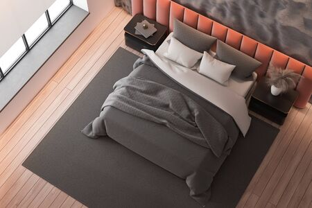 Top view of modern bedroom with crude gray and pink walls, wooden floor, orange king size bed standing on gray carpet and two bedside tables. 3d rendering Reklamní fotografie