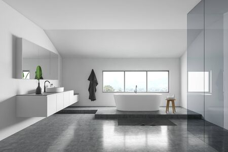 Interior of minimalistic bathroom with white walls, concrete floor, comfortable white bathtub near window and round sink with big mirror. 3d rendering