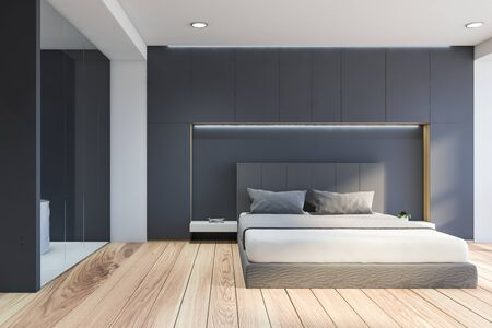 Interior of modern bedroom with white and grey walls, wooden floor, comfortable king size bed and bathroom with bathtub in background. 3d rendering.