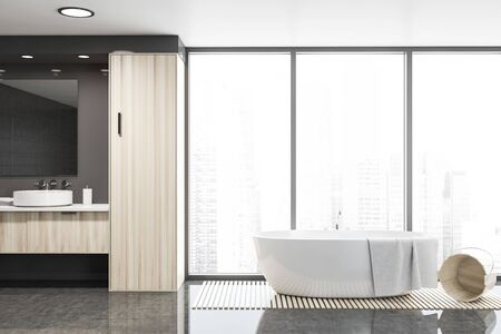 Interior of panoramic bathroom with gray walls, glossy floor, comfortable bathtub and round sink on wooden countertop. 3d rendering