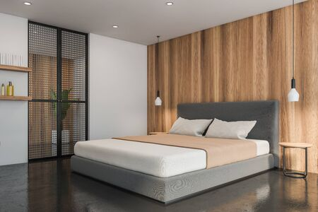 Corner of modern bedroom with white and wooden walls, concrete floor, comfortable master bed with beige blanket and two bedside tables. 3d rendering Reklamní fotografie