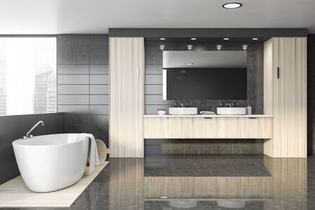Interior of spacious bathroom with gray tile walls, glossy and wooden floor, comfortable bathtub and double sink standing on wooden countertops. 3d rendering
