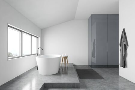 Side view of minimalistic bathroom with white walls, concrete floor, comfortable white bathtub under window and chair with towels. 3d rendering Stok Fotoğraf