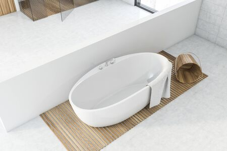 Top view of comfortable white bathtub standing in spacious bathroom interior with white walls and concrete floor. Concept of spa. 3d rendering