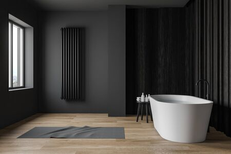 Side view of comfortable bathroom with gray and dark wooden walls, wooden floor and cozy white bathtub with water. 3d rendering