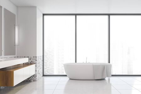 Interior of comfortable bathroom with white and mosaic walls, tiled floor, cozy white sink with cabinets and vertical mirrors and bathtub near panoramic window. 3d rendering Stock fotó - 133470958