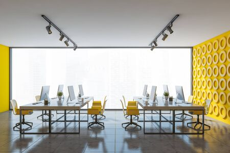 Interior of panoramic open space office with yellow geometric pattern walls, stone floor and long white computer tables with yellow chairs. 3d rendering Stock Photo