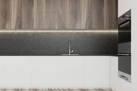 Close up of comfortable white kitchen countertop with built in sink standing in modern kitchen with concrete walls and wooden cupboards. 3d rendering Banco de Imagens - 133771625