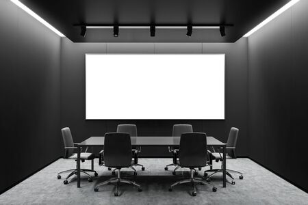 Interior of modern meeting room with black walls, concrete floor, gray conference table with chairs and horizontal mock up poster frame. 3d rendering Banco de Imagens - 133771628