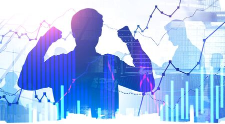 Silhouette of successful young businessman celebrating victory with his team in abstract city with double exposure of graphs. Concept of leadership and trading. Toned image Banco de Imagens