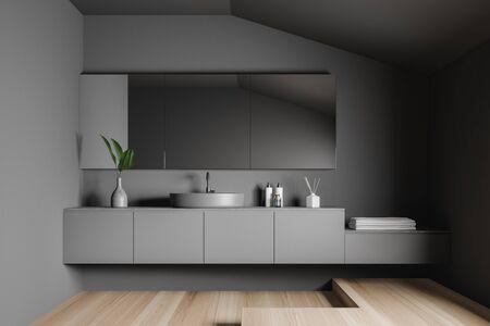 Interior of attic minimalistic bathroom with grey walls, wooden floor, comfortable round sink on gray countertop and big mirror. 3d rendering Zdjęcie Seryjne