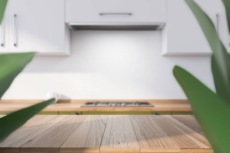 Table for your product in blurry spacious kitchen with white walls, green countertops with built in cooker and white cupboards. Concept of advertising. 3d rendering