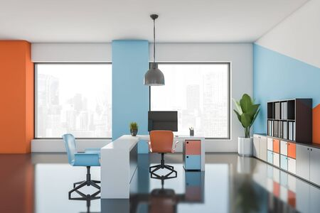 Interior of bright office workplace with white, blue and orange walls, gray floor, comfortable tables with bright chairs and bookcases with folders. 3d rendering Stock Photo - 133854475