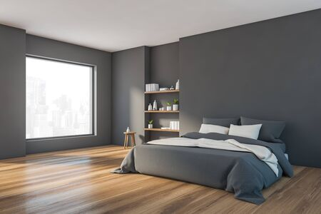 Corner of stylish minimalistic bedroom with grey walls, wooden floor, comfortable king size bed with gray blanket and bookshelves. Window with cityscape. 3d rendering