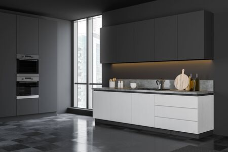 Corner of minimalistic kitchen with dark gray walls, tiled floor, white countertops and grey cupboards, window with cityscape and built in appliances. 3d rendering