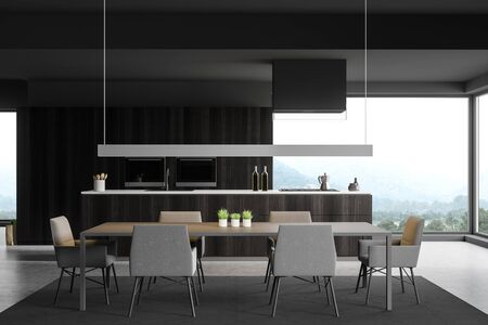 Interior of panoramic kitchen with gray walls, concrete floor, dark wooden island with built in sink and cooker and dining table with chairs. 3d rendering