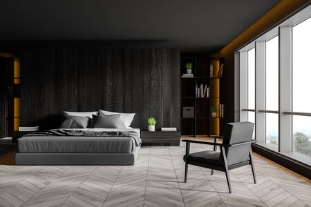 Interior of comfortable master bedroom with dark wooden walls, wooden floor, king size bed with two bedside tables, bookshelves and gray armchair near big window. 3d rendering