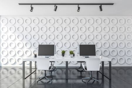 Interior of open space office with white geometric pattern walls, gray floor and long white computer tables with white chairs. 3d rendering Stock Photo - 133854581