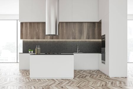 Interior of luxury kitchen with white walls, wooden floor, panoramic windows, wooden cupboards and white countertops. Island with built in stove. 3d rendering