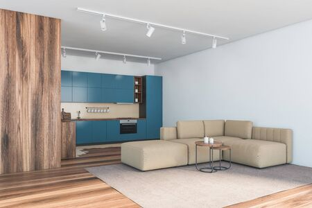 Corner of spacious kitchen and living room with and wooden walls, blue countertops and comfortable beige sofa with two coffee tables. 3d rendering