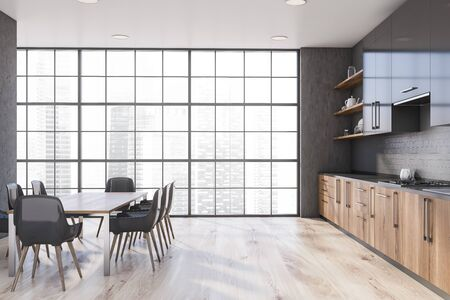 Interior of spacious kitchen with concrete walls, wooden floor, panoramic window, wooden countertops and gray cupboards. Long dining table with gray chairs. 3d rendering Zdjęcie Seryjne
