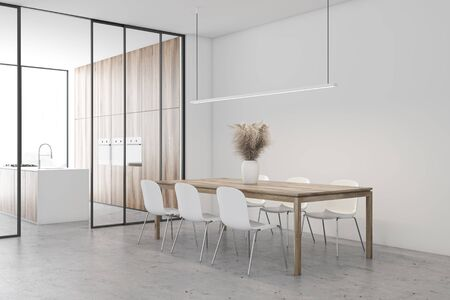 Corner of spacious dining room with white walls, concrete floor, long wooden table with chairs and kitchen with wooden walls and island in background. 3d rendering 版權商用圖片