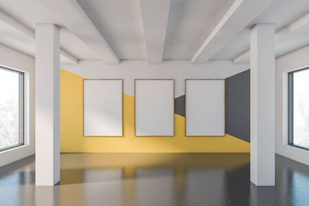 Empty room interior with white, yellow and gray walls, concrete floor, columns and three vertical mock up poster frames. 3d rendering