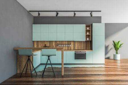 Interior of modern kitchen with gray walls, wooden floor, blue countertops with built in appliances and bar with stools. 3d rendering