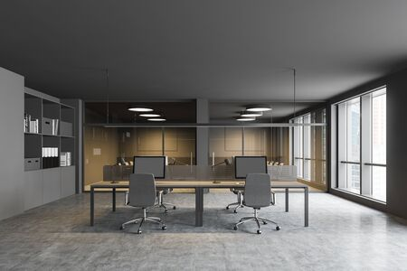 Comfortable open space office interior with gray walls, concrete floor, big computer tables, two conference room and bookcases with folders. 3d rendering Stock Photo