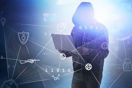Hacker in hoodie using laptop over blue background with double exposure of big data interface. Toned image Stock Photo - 133854967