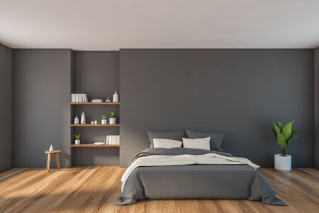 Interior of stylish minimalistic bedroom with grey walls, wooden floor, comfortable king size bed with gray blanket and bookshelves. 3d rendering Reklamní fotografie