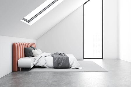 Side view of attic bedroom with white walls, concrete floor, comfortable orange king size bed and white bedside table. 3d rendering Reklamní fotografie - 133855160