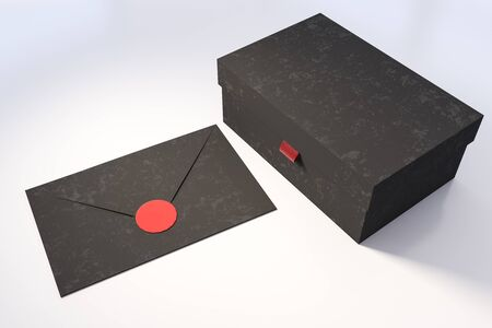 Closed black gift box and black envelope lying on white table. Concept of holidays and celebration. 3d rendering Stock fotó