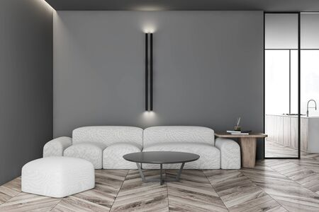 Interior of modern living room with gray walls, wooden floor, comfortable white sofa with round coffee table and kitchen in background. 3d rendering