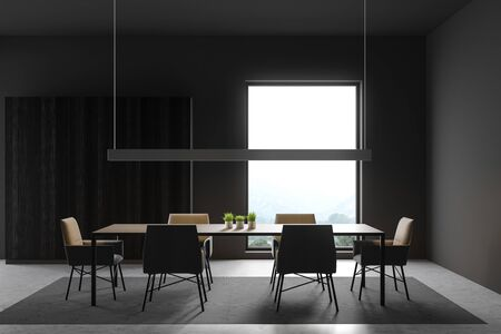 Interior of minimalistic dining room with dark gray walls, concrete floor, long gray table with chairs standing on carpet and wooden wardrobe. 3d rendering 스톡 콘텐츠 - 133855204