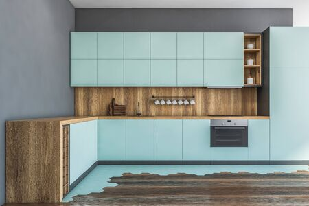 Interior of stylish kitchen with gray walls, wooden floor, blue countertops and cupboards and built in appliances. 3d rendering
