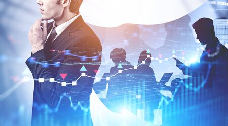 Pensive businessman in imaginary cape in abstract city with double exposure of business people and blurry graphs. Concept of leadership. Toned image