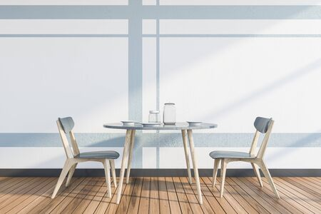 Interior of minimalistic dining room with white and light gray walls, wooden floor and round table with chairs. 3d rendering