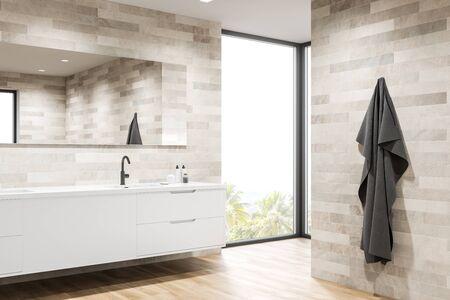 Corner of modern bathroom with light tiled walls, wooden floor, sink standing on white countertop and big mirror. 3d rendering