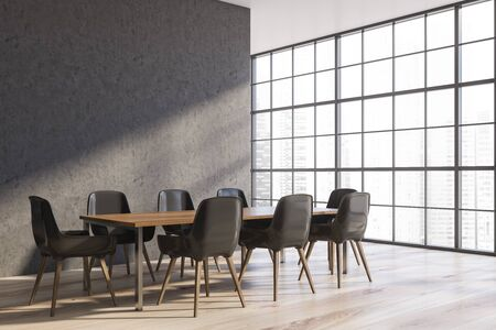 Corner of stylish dining room with concrete walls, wooden floor, panoramic window and long wooden table with gray chairs. 3d rendering 스톡 콘텐츠