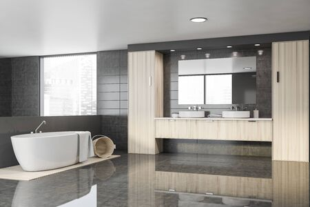 Corner of spacious bathroom with gray tile walls, glossy and wooden floor, comfortable bathtub and double sink standing on wooden countertops. 3d rendering 스톡 콘텐츠 - 133855318