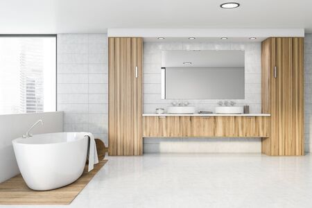 Interior of spacious bathroom with white tile walls, concrete and wooden floor, comfortable bathtub and double sink standing on wooden countertops. 3d rendering 스톡 콘텐츠