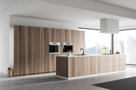 Corner of panoramic kitchen with white walls, concrete floor, wooden countertops and two built in ovens. 3d rendering 스톡 콘텐츠