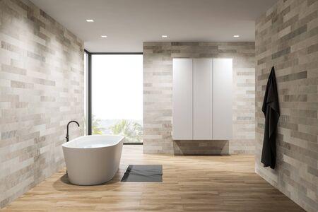 Interior of loft minimalistic bathroom with light tile walls, wooden floor, comfortable white bathtub and wardrobe. 3d rendering