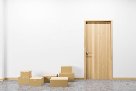 Stack of cardboard boxes standing near closed door in modern house corridor. Concept of delivery and logistics and moving to new house. 3d rendering 스톡 콘텐츠 - 133855358