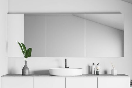 Close up of stylish white round bathroom sink standing on white countertop in room with white walls and big mirror. 3d rendering 스톡 콘텐츠