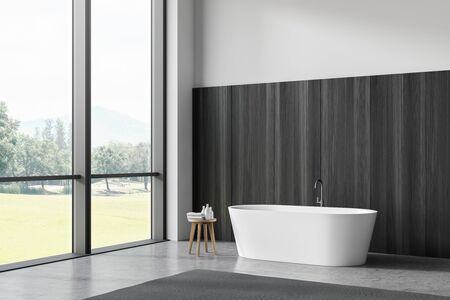 Corner of comfortable bathroom with white and dark wooden walls, concrete floor and cozy white bathtub near window with beautiful view. 3d rendering