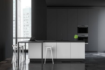 Interior of spacious modern kitchen with dark grey walls, tiled floor, gray cupboard with built in ovens and white bar with stools. 3d rendering