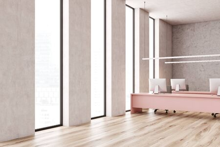 Corner of minimalistic open space office with concrete walls, wooden floor, narrow windows and long pink computer tables with gray chairs. 3d rendering Stock Photo - 133855376