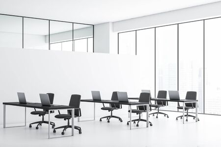 Interior of panoramic open space office with white walls and floor, row of black tables with laptops and window with cityscape. 3d rendering Stock fotó